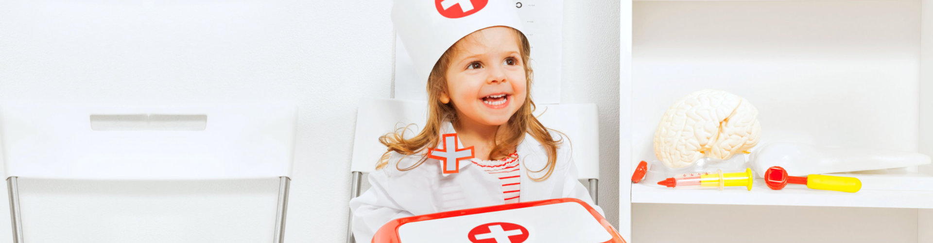 young girl wearinga nurse's hat