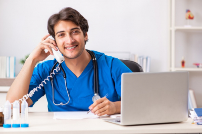 Doctor in telemedicine concept with phone