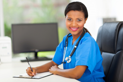 portrait of pretty female african doctor in modern office