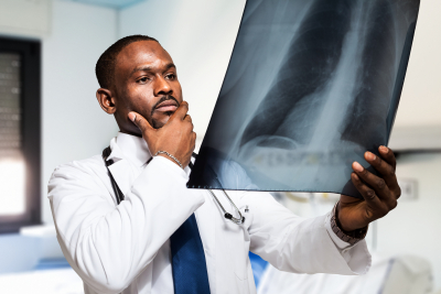 doctor looking at a radiograph